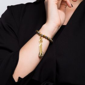A Crystal Clad Bracelet With The Letter أ In A Mirror Gold Finish